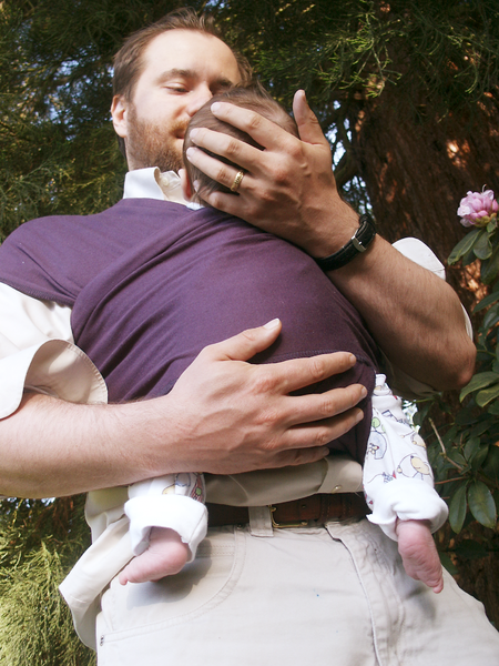 Dad carrying baby in stretchy wrap for Daddy carrier