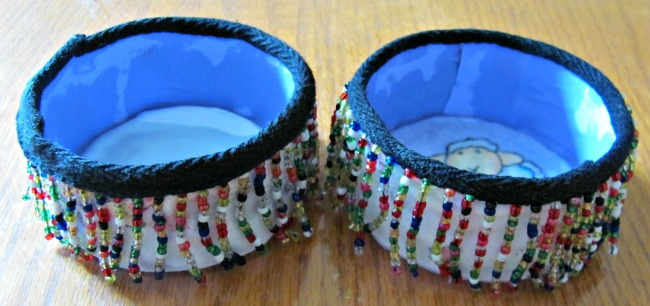 Tin cans with decorative bead fringe