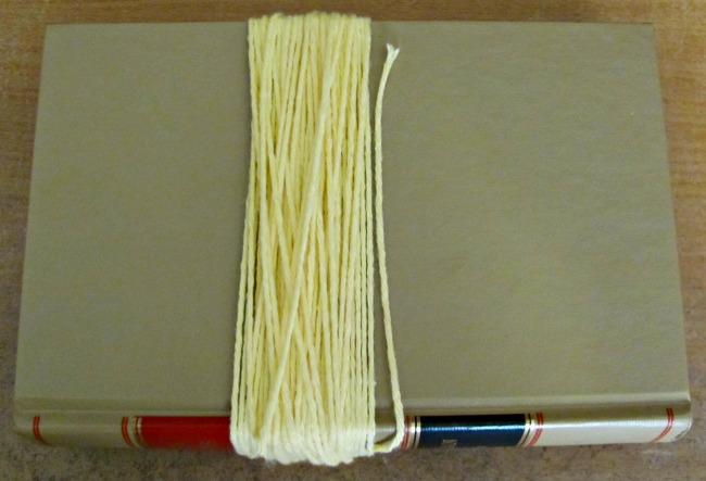 Yarn wrapped around a hardcover book