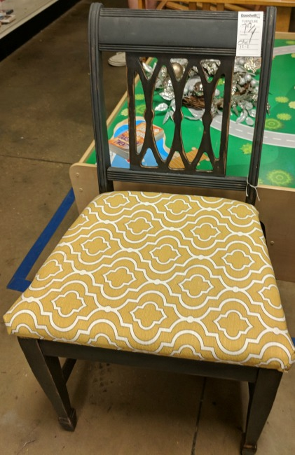 Find a lovely accent chair for added seating and a pop of color at Goodwill.